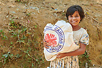 Jaibunnessa, an 11-year old Rohingya girl, carries home a bag of food provided by Caritas in the Mainerghona Refugee Camp near Cox's Bazar, Bangladesh, on October 27, 2017. She and her family are among the more than 600,000 Rohingya who since August have fled government-sanctioned violence in Myanmar for safety in Bangladesh.