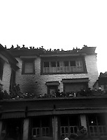 People crowded on roof tops for summer solstice ceremony Drikung (Drigung) Valley Monastery, Tibet.