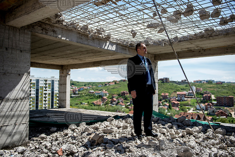 The new mayor or Pristina (Prishtina) Shpend Ahmeti surveys the destruction of one of Prishtina's multitude of illegal buildings.