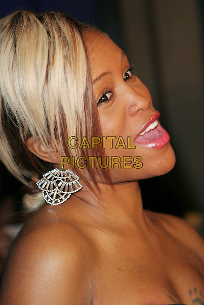 EVE.U.S. launch party for the new BlackBerry Bold from AT&T, Beverly Hills, California, USA..October 30th, 2008.headshot portrait strapless mouth open silver earrings look closer bad skim pimples acne  .CAP/ADM/TC.©T. Conrad/AdMedia/Capital Pictures.