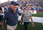 Former Nevada head coach Chris Ault and his wife Kathy enter the field for a pre-game ceremony to rename Mackay Stadium as Chris Ault Field before a college football game between UC Davis and Nevada, in Reno, Nev., on Saturday, Sept. 7, 2013. (AP Photo/Cathleen Allison)