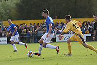 Lee Wallace being chased by Ryan McIntosh in the Forres Mechanics v Rangers William Hill Scottish Cup 2nd Round match, at Mosset Park, Forres on 29.9.12.