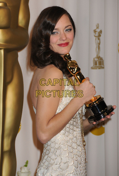 MARION COTILLARD.The 80th Annual Academy Awards Press Room held at the Kodak Theatre, Hollywood, California, USA..February 24th, 2008.oscars award trophy winner half length white silver dress.CAP/ADM/BP.©Byron Purvis/AdMedia/Capital Pictures.