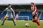 Olivia Fergusson (r) of Sheffield United runs at Asmita Ale of Aston Villa during the The FA Women's Championship match at the Proact Stadium, Chesterfield. Picture date: 12th January 2020. Picture credit should read: James Wilson/Sportimage