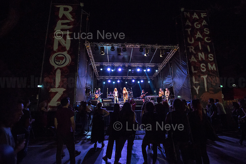"""Tina Costa (Antifascist Partizan. Member of the Partigiani: the Italian Resistance during WWII).<br /> <br /> Rome, 01/09/2018. Documenting the antifascist """"Renoize Festival 2018"""" at Schuster Park in rome. The annual musical, political and cultural event saw various bands playing, including Nosenzo (), Hi Shine (https://bit.ly/2NwFR5o) Feat. Sista Gaia & Sista Anja - Voices of Los3saltos (https://bit.ly/2wYJAhZ) and Clementino (https://bit.ly/2O3lDNA). Special guests of the Festival: Stefania, Mother of Renato Biagetti, the Association """"Madri Per Roma Cittá Aperta"""" and Tina Costa (Partizan, Member of the Italian Resistance during WWII). <br /> The Fesival is dedicated to Renato Biagetti, the 26 year old sound engineer and activist of the Rome's Social Centre Acrobax. Renato Biagetti was stabbed to death the night of the 27 August 2006 by two neo-fascists while he was going back home with his girlfriend and a friend (both attacked and injured as well) after a reggae concert in Focene, on the Lazio's coast near Rome.<br /> <br /> For more info please click here: https://www.facebook.com/events/1997311230582084/ & https://www.facebook.com/12-anni-di-Renato-ionondimentico-1218120291536169/<br /> <br /> For More info about Nosenzo please click here: https://bit.ly/2H0nOSM & https://bit.ly/1IFlc6P & https://bit.ly/2qztM1T & https://bit.ly/2qAhqYe<br /> <br /> For more photos of the Partizan Tina Costa please click here: https://bit.ly/2wTihp2"""