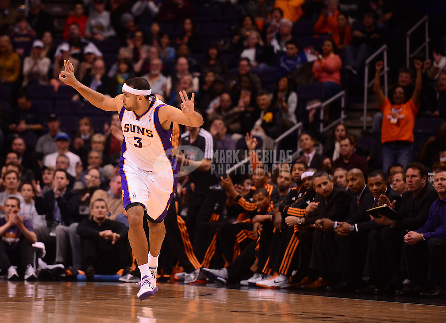 Jan. 2, 2013; Phoenix, AZ, USA: Phoenix Suns forward Jared Dudley celebrates a first quarter three pointer against the Philadelphia 76ers at the US Airways Center. Mandatory Credit: Mark J. Rebilas-USA TODAY Sports