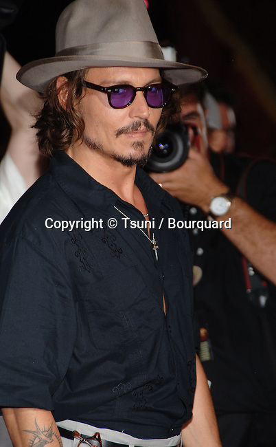 Johnny Depp  arriving at the Pirates Of The Caribbean Premiere - Dead Man Chest - at Disneyland  In Los Angeles. June 24, 2006.