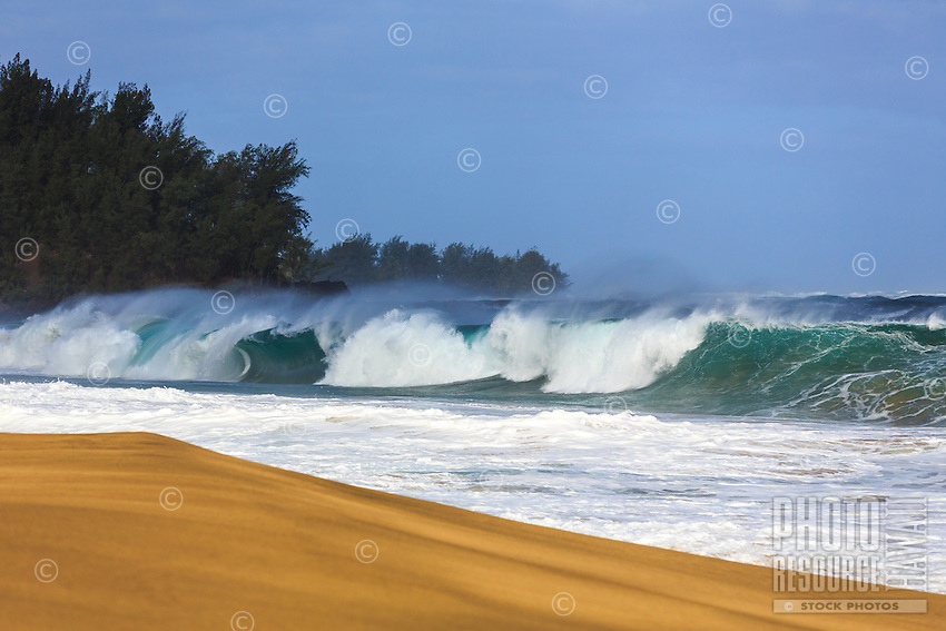 A large winter swell breaks onto the sand at Lumaha'i Beach on the north shore of Kaua'i.