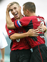 26 June 2004:  Dallas Burn Midfielder Ronnie O'Brien celebrates with Jason Kreis after Kreis scored opening game goal against DC United at Cotton Bowl in Dallas, Texas.   DC United and Dallas Burn are tied 1-1 after the game.  Credit: Michael Pimentel / ISI
