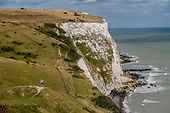 Hiker on the south-eastern coastal path as it crosses the White Cliffs of Dover, Kent.