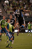 Quincy Amarikwa (25) heads the ball against Roger Levesque (2nd from left) as Sebastien Le Toux (l) and Jason Hernandez (2nd from right) look on in the Seattle Sounders 2-1 win against San Jose Earthquake on Saturday, June 13, 2009 at Quest Field in Seattle, WA.