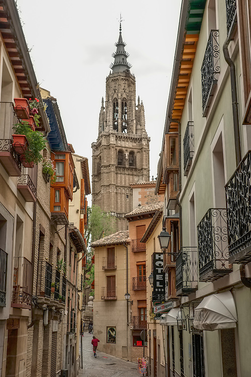 The cathedral spire presides over the quaint  back streets in Toledo.