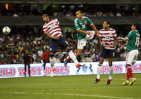 MEXICO CITY, MEXICO - AUGUST 15, 2012:  Terrence Boyd (18) of the USA MNT heads the ball away from Jorge Torres Nilo (20) of  Mexico during an international friendly match at Azteca Stadium, in Mexico City, Mexico on August 15. USA won 1-0.