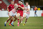 Dan Norton of England (left) tries to stop Isaac Kaay of Canada, who runs with the ball during the match Canada vs England, Day 2 of the HSBC Singapore Rugby Sevens as part of the World Rugby HSBC World Rugby Sevens Series 2016-17 at the National Stadium on 16 April 2017 in Singapore. Photo by Victor Fraile / Power Sport Images