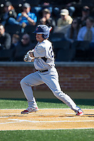 Daniel Brumbaugh (23) of the Richmond Spiders follows through on his swing against the Wake Forest Demon Deacons at David F. Couch Ballpark on March 6, 2016 in Winston-Salem, North Carolina.  The Demon Deacons defeated the Spiders 17-4.  (Brian Westerholt/Four Seam Images)