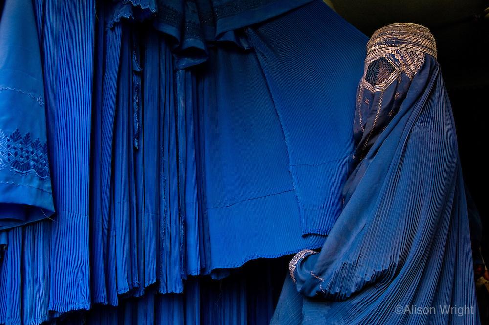 Women shopping for burkas.