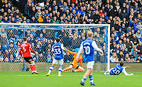 GOAL:- Sheffield Wednesday's midfielder Adam Reach (20) hits it into the floor sending Barnsley's goalkeeper Adam Davies (1) the wrong way and the ball into the corner during the Sky Bet Championship match between Sheff Wednesday and Barnsley at Hillsborough, Sheffield, England on 28 October 2017. Photo by Stephen Buckley / PRiME Media Images.