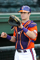 Catcher Chris Okey (25) of the Clemson Tigers prior to a fall Orange & Purple intrasquad scrimmage on November 2, 2013, at Fluor Field at the West End in Greenville, South Carolina. Orange won 7-1.(Tom Priddy/Four Seam Images)