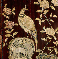 A detail of a lacquered Coromandel screen in Coco Chanel's Paris apartment decorated with camelias and a phoenix