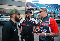 May 31, 2019; Joliet, IL, USA; NHRA top fuel driver Dom Lagana (left) with brother Bobby Lagana (center) and crew chief Aaron Brooks during qualifying for the Route 66 Nationals at Route 66 Raceway. Mandatory Credit: Mark J. Rebilas-USA TODAY Sports