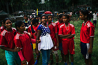 JAIPALGURI, INDIA- AUGUST 15: Player and coach of the female football team, the Dooars XI,  Bhabani Munda, 24, speaks with her players after their loss after a penalty shoot-out during a local football derby on Indian Independence day on August 15, 2013 at the Kalchini Tea Estate In Jalpaiguri district  West Bengal. The Kalchini tea estate where Bhabani Munda lives is one of the most interior and backwards regions in north Bengal. The tea estates of North Bengal, including the Kalchini tea estate, were in news in 2007-08 for large-scale starvation deaths owing to malnutrition. Even today one person dies every day due to starvation in the north Bengal tea estates. In the last decade there have been 3500 deaths in these tea estates. (Photo by Daniel Berehulak for Time Magazine)