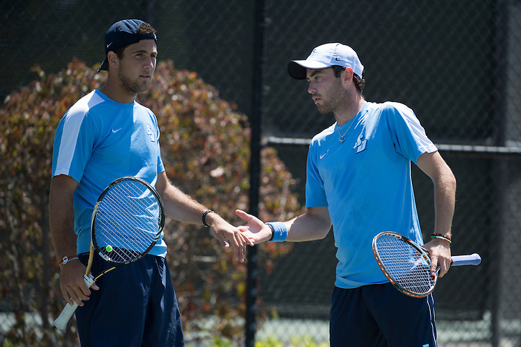 April 25, 2013; San Diego, CA, USA; San Diego Toreros players Victor Pugliese (left) and Ciaran Fitzgerald (right) during the WCC Tennis Championships at Barnes Tennis Center.