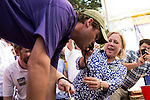 Sen Mary Landrieu, D-La., holds a beer keg nozzle for an LSU football fan as he does a keg stand during the tailgate party on the Louisiana State University campus before the LSU-Mississippi State game on Saturday, Sept. 20, 2014.