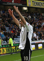 Nicky Clark salutes the away fans in the Rangers v Queen of the South Quarter Final match in the Ramsdens Cup played at Ibrox Stadium, Glasgow on 18.9.12.