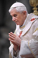 Pope Benedict XVI blesses as he celebrates the solemnity of Mary the Mother of God mass and the 45th World Day of Peace at the Vatican basilica. on January 1, 2012
