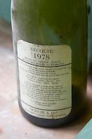 The first vintage 1978, 80% Cabernet Sauvignon, 20% Malbec, Merlot, Syrah, Cabernet Franc, Pinot and Tannat. Back label. Domaine du Mas de Daumas Gassac. in Aniane. Languedoc. France. Europe. Bottle.