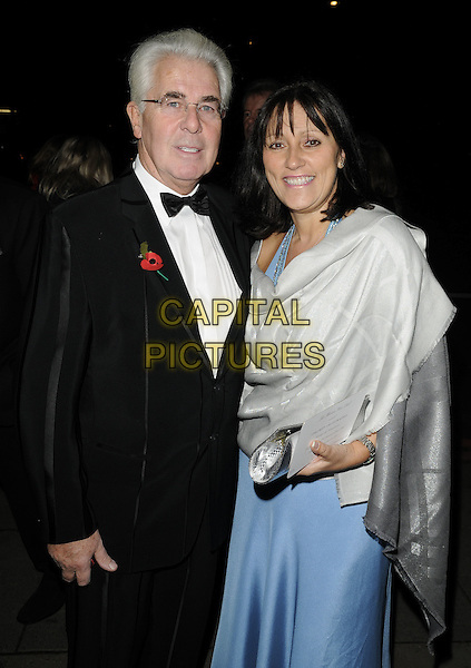 MAX CLIFFORD & JO WESTWOOD (wife).At the Marion Rose Ball, Grosvenor House hotel, London, England, UK, November 13th 2010..half length black tuxedo tux bow tie glasses blue dress grey gray wrap shawl silk satin couple married poppy .CAP/CAN.©Can Nguyen/Capital Pictures.