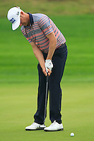 Mikko Ilonen (FIN) putts on the 1st green during Thursday's Round 1 of the 2014 BMW Masters held at Lake Malaren, Shanghai, China 30th October 2014.<br /> Picture: Eoin Clarke www.golffile.ie