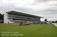Early race goers enjoying the evening at the Racenight with Reggie Yates Meeting at Hamilton Park Racecourse on 14.7.12.