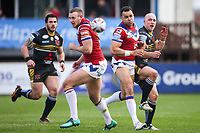 Picture by Alex Whitehead/SWpix.com - 12/03/2017 - Rugby League - Betfred Super League - Wakefield Trinity v Salford Red Devils - Beaumont Legal Stadium, Wakefield, England - Salford's Michael Dobson (R) kicks the ball.