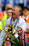 Manchester United manager Sir Alex Ferguson with the Premier League Trophy during the Premier League match at The JJB Stadium, Wigan. Picture date 11th May 2008. Picture credit should read: Simon Bellis/Sportimage