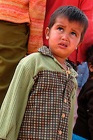 A child is pictured in the wilaya of Ausserd on December 12, 2003.Saharawi people have been living at the refugee camps of the Algerian desert named Hamada, or desert of the deserts, for more than 30 years now. Saharawi people have suffered the consecuences of European colonialism and the war against occupation by Moroccan forces. Polisario and Moroccan Army are in conflict since 1975 when Hassan II, Moroccan King in 1975, sent more than 250.000 civilians and soldiers to colonize the Western Sahara when Spain left the country. Since 1991 they are in a peace process without any outcome so far. (Ander Gillenea / Bostok Photo)