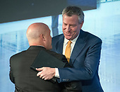 Mayor Bill de Blasio (Democrat of New York, NY) hugs Mayor Mitchell J. Landrieu (Democrat of New Orleans, LA) prior to making remarks at a plenary session of the United States Conference of Mayors in Washington, DC on Thursday, January 25, 2018.<br /> Credit: Ron Sachs / CNP<br /> (RESTRICTION: NO New York or New Jersey Newspapers or newspapers within a 75 mile radius of New York City)