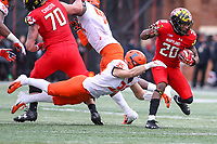 College Park, MD - October 27, 2018: Maryland Terrapins running back Javon Leake (20) avoids the tackle by Illinois Fighting Illini linebacker Jake Hansen (35) during the game between Illinois and Maryland at  Capital One Field at Maryland Stadium in College Park, MD.  (Photo by Elliott Brown/Media Images International)