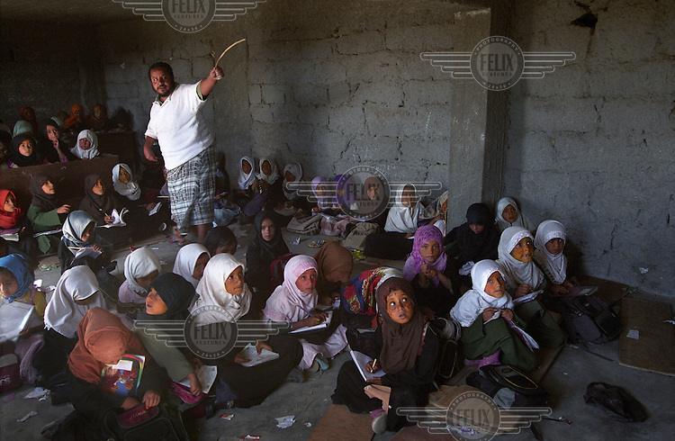 Typical village school in Thi Sura in Yafa. For centuries men have been leaving Yafa, a poor, rural and very mountainous area, to seek work elsewhere.