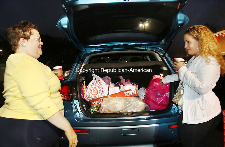 WATERBURY CT. 26 November 2015-112715SV03-Elizabeth Santiago and her daughter Alexa Santiago both of Waterbury load their car after picking up a few items at Target 6:30am in Waterbury Friday. The two started shopping at 3pm Thursday, took a 2-hour nap and continued with their Black Friday shopping. <br /> Steven Valenti Republican-American