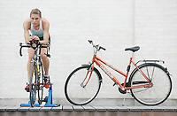 29 JUN 2007 - COPENHAGEN, DEN - British Junior Hollie Avil does a turbo session outside the team hotel - European Triathlon Championships. (PHOTO (C) NIGEL FARROW)