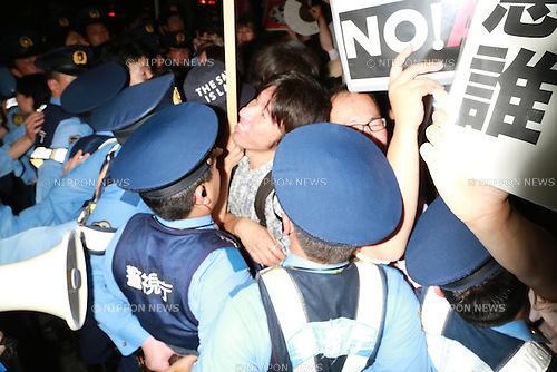Tokyo, Japan - Protesters clash with police during the rally against the cabinet's decision to change the article 9 of the Constitution which prohibits Japan from possessing military power other than the minimum necessary to defend the nation, along to the Prime Minister's official residence and National Diet on June 30, 2014. The rally runs a day before to the cabinet will announce the final decision to officially acknowledge Japan's right to collective defense in the meeting. (Photo by Rodrigo Reyes Marin/AFLO)