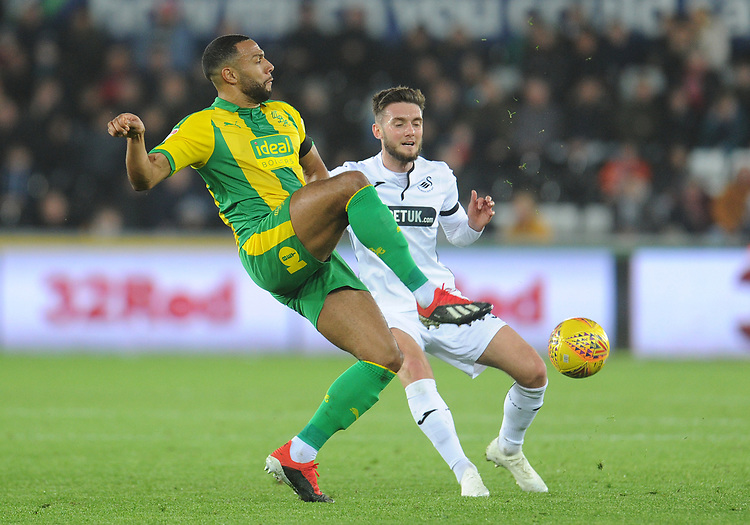 West Bromwich Albion's Matt Phillips under pressure from Swansea City's Matt Grimes<br /> <br /> Photographer Kevin Barnes/CameraSport<br /> <br /> The EFL Sky Bet Championship - Swansea City v West Bromwich Albion - Wednesday 28th November 2018 - Liberty Stadium - Swansea<br /> <br /> World Copyright &copy; 2018 CameraSport. All rights reserved. 43 Linden Ave. Countesthorpe. Leicester. England. LE8 5PG - Tel: +44 (0) 116 277 4147 - admin@camerasport.com - www.camerasport.com