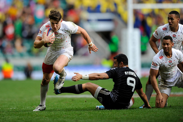 Chris Cracknell of England dances through the tackle of Sherwin Stowers of New Zealand during Day One of the iRB Marriott London Sevens at Twickenham on Saturday 10th May 2014 (Photo by Rob Munro)