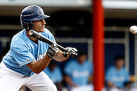 14 July 2011: Julien Brelle Andrade of Senart Templiers eyes the ball at bat for a bunt during the 2011 Challenge de France match won 12-9 by the Senart Templiers over Pessac Pantheres, at Stade Pierre Rolland, in Rouen, France.