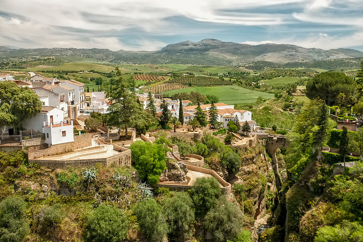 Viewed from the New Bridge in Ronda, the quaint village dwellings and this rural area of Spain are on full display.