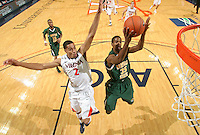 Dec. 20, 2010; Charlottesville, VA, USA; Norfolk State Spartans guard/forward Chris McEachin (35) floats in front of the rim with Virginia Cavaliers guard Mustapha Farrakhan (2) during the game at the John Paul Jones Arena. Virginia won 50-49. Mandatory Credit: Andrew Shurtleff-