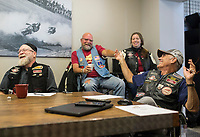 NWA Democrat-Gazette/CHARLIE KAIJO Club president Jim Hiland of Bentonville interacts with Mark Campbell of Bentonville (center), seated between Mark Goldsmith of Bella Vista and Wendy Widener of Gentry at the Heritage Indian Motorcycle club and show room in Rogers, AR on Saturday, September 9, 2017. The Indian riders gathered to discuss plans for the upcoming Bikes, Blues and BBQ rally