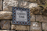 A ceramic tile sign for the Garden Tomb in Jerusalem, just north of the Damascus Gate and outside the walls of the ancient city.  The Garden Tomb is thought by many to be the burial place of Jesus Christ, rather than in the Church of the Holy Sepulchre.  Nearby is a hill thought by many to be Golgotha, the site of the crucifixion of Christ.