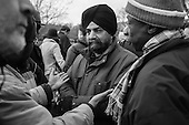 Speakers' Corner, Hyde Park, London.  A Sikh, Muslim and Christian discuss religion.